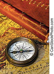 old diary and compass - an old diary or notebook with a...