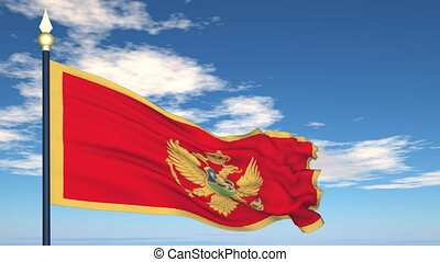 Flag Of Montenegro on the background of the sky and flying...