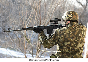 Portrait of soldier with a sniper rifle