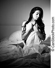 lonely woman - lonely young woman in her bed at home at...