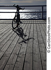 bicycle at the pier - Bike at the pier, jetty in morning sea...