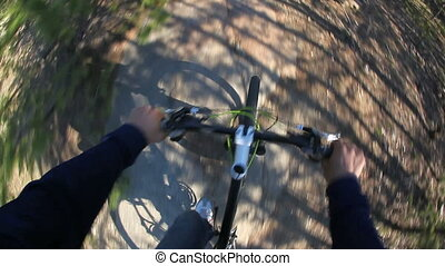 Riding a bike - Fisheye of a bike ride in the forest Cyclist...
