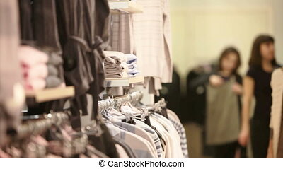 Girl choosing pullover - Attractive blond girl choosing a...