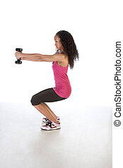 Slim ethnic woman working out with black dumbbell - Young...