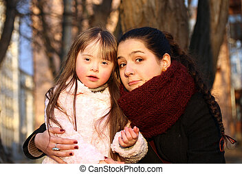 Family moments - Mother and child have a fun in the park.