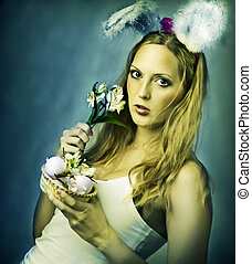 Sexy woman - easter bunny with basket of eggs