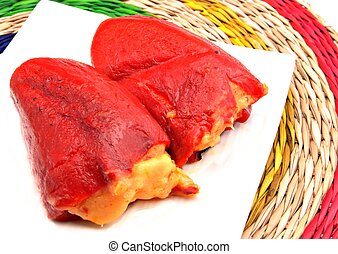 Piquillo peppers stuffed with cod b?chamel on a white plate