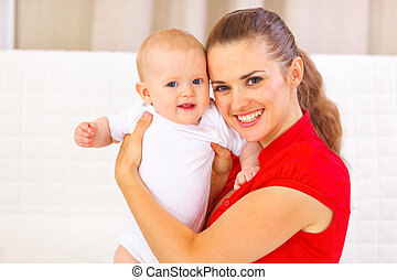 Portrait of adorable baby and young mother
