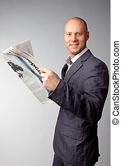 daily newspaper - Portrait of a businessman reading a daily...