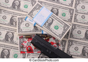 pistol - A pistol with a bloodstained one-dollar bill and...