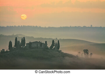 Landscape in Tuscany - Beautiful view of sunrise in Tuscany,...