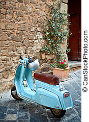 Italian style - Classic Italian scooter in the small alley...