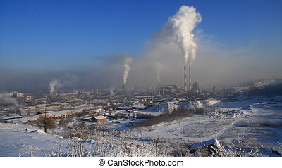 Power Station 24 - Smoke from an industrial pipe on a...