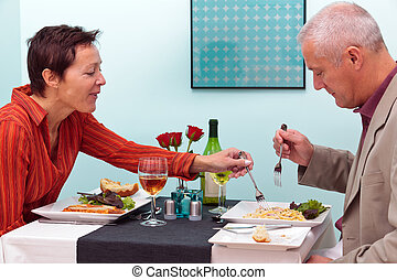 Mature couple in a restaurant - Photo of a mature couple...