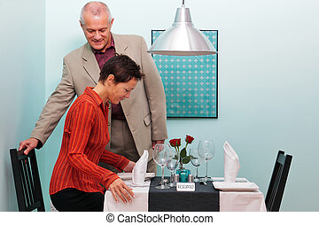 Mature couple sitting down in a restaurant - Photo of a...