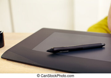 Graphics Tablet And Pen - Clsoeup of a graphics tablet and...