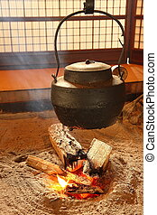 warm Japan teapot with fire in japanese-style living room