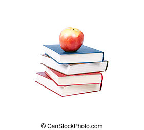 Four books on top of apples.