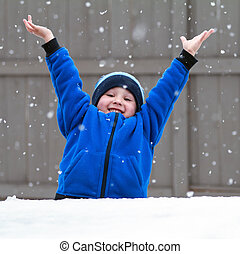 catching snowflakes - smiling boy catching snowflakes