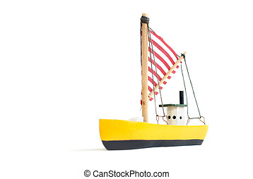 Small wooden sailing ship - Small yellow toy sailing boat on...