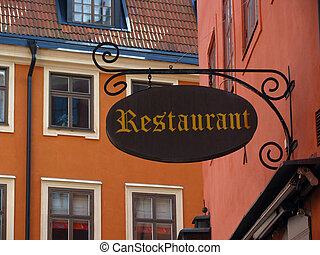 Old restaurant sign - Vintage restaurant sign in a old town,...
