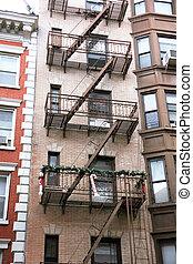usa, new york, greene street, soho. fire escapes to the...