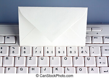 computer keyboard and envelope. e-mail. - the keyboard of a...