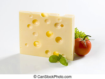 Swiss cheese - Slice of hard cheese and a tomato