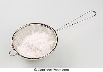 Sieve - Heap of powdered sugar in a sieve