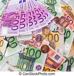 many euro banknotes of the european union. debt and budget