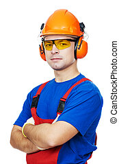 builder in hard hat, earmuffs and goggles - Portrait of...