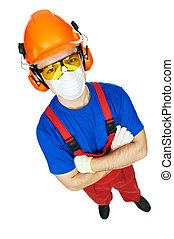 builder in hardhat, earmuffs, goggles and gas mask