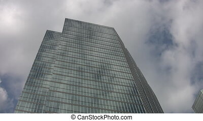 Skyscraper and clouds. Timelapse.