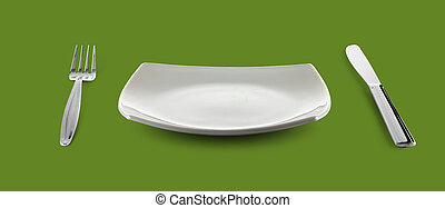 empty square plate or dish for food with fork and knife on green table
