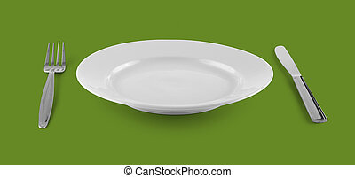 empty plate or dish for food with fork and knife on green table