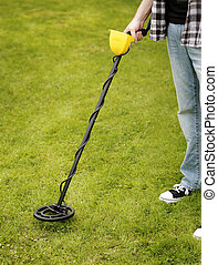 Metal Detector - Man using a metal detector on lawn