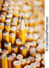 Standing out from the crowd - Sharpened pencil amongst the...
