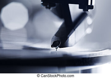 Vinyl Sound - Closeup of a turntable stylus playing on a...