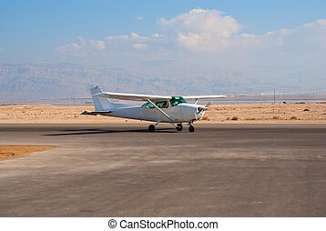 Cessna-172 - White Cessna-172 light airplane on the desert...