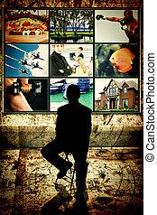 silueta, homem, sentando, frente, vídeo, parede