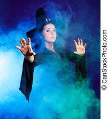 sexy witch - brunette witch saying the spell and stretching...