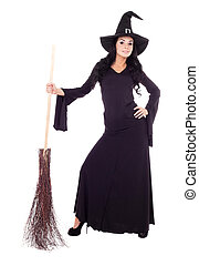 witch with a broom - pretty young brunette witch with a...
