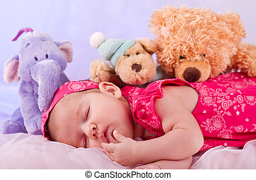newborn baby - View of a newborn baby on smooth bed with...