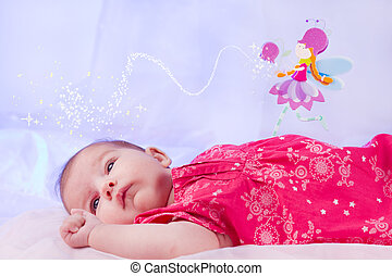 newborn baby - View of a newborn baby on a smooth bed with...