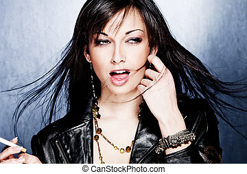 black hair woman in leather jacket, studio shot