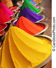 Colorful piles of powdered dyes on display - Colorful piles...