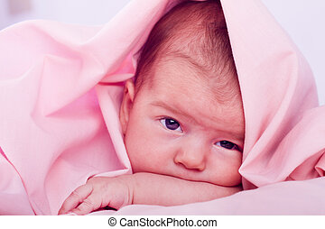 newborn baby - View of a newborn baby on a smooth bed hidden...