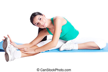 girl stretching - beautiful young brunette woman stretching...