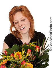 Happy and surprised young woman with a beautiful bunch of flowers. Isolated on white.