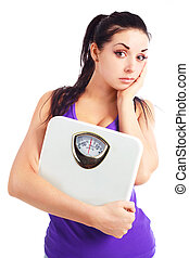 sad girl with scales - young upset woman wearing sports...